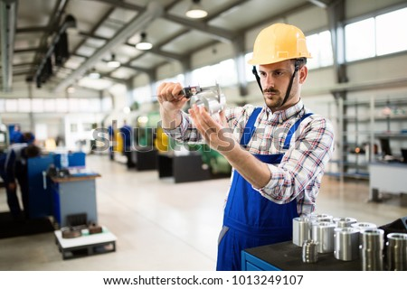 Supervisor doing quality control and pruduction check in factory