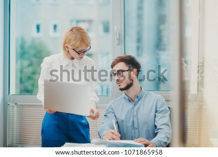 Supervisor giving feedback to intern at the office