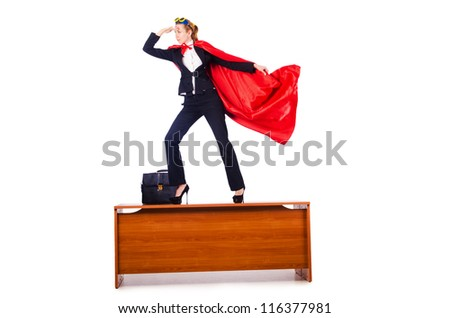 Superwoman standing on the desk - stock photo