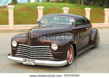 """SUPHANBURI, THAILAND - MARCH 31: Classic Retro Car exhibited at the annual motor show """"American Car Carnival"""" on March 31, 2012 in Suphanburi, Thailand."""