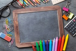 Supplies and chalk board for your text. Back to school concept with copy space