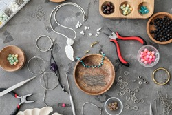 Supplies for jewelry manufacturing on grunge background