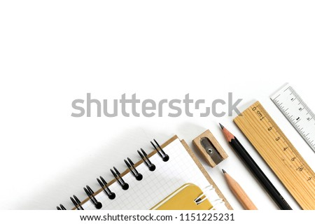 Supplies- scissors, pencils, paper clips,note,stapler and notepad, globe on blue background,flatlay,Stationary, back to school,creativity and education concept.