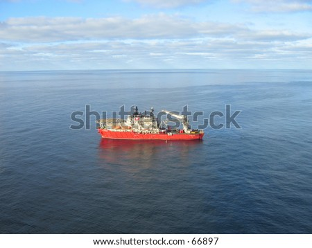 Supply boat on oil field.