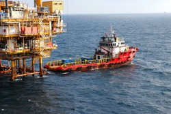 Supply boat transfer cargo to oil and gas industry and moving cargo from the boat to the platform