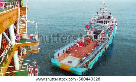 Supply boat transfer cargo to oil and gas industry and moving cargo from the boat to the platform,