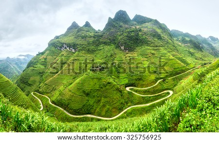Supply lines of Ma Pi Leng Pass rugged northwest Vietnam's most beautiful with winding road full of clouds mountainside. We come to love the country of Vietnam more