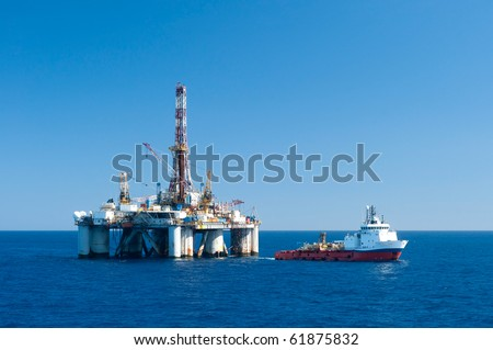Supply vessel during operation along side with a drilling rig.  Coast of Brazil #61875832