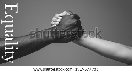 Support. African and caucasian hands gesturing on gray studio background. Tolerance and equality, unity, support, kindly coexistence together concept. Worldwide multiracial community. Flyer. Stock fotó ©