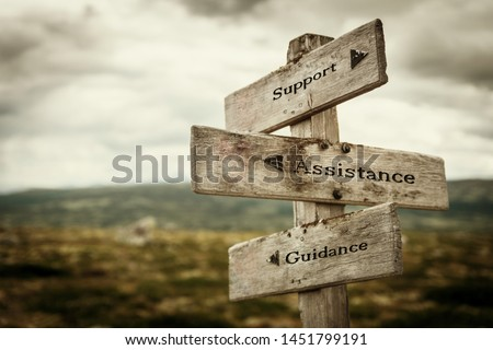 Support, assistance and guidance signpost outdoors in nature. Moody feeling. Need help, call for help, helping, stuck, road concept. #1451799191