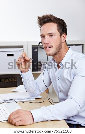Support hotline call-agent working in call center with headset