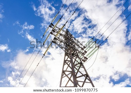 support of electro transmission lines against blue sky #1099870775