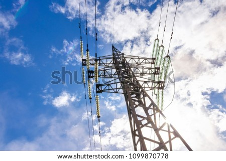 support of electro transmission lines against blue sky #1099870778
