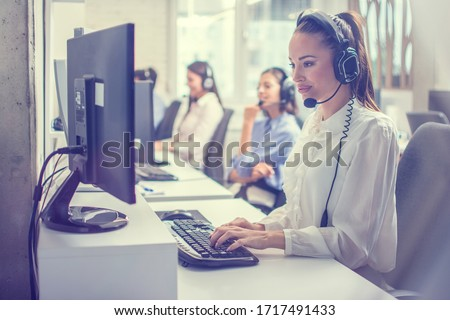 Support phone operator woman in headset at workplace