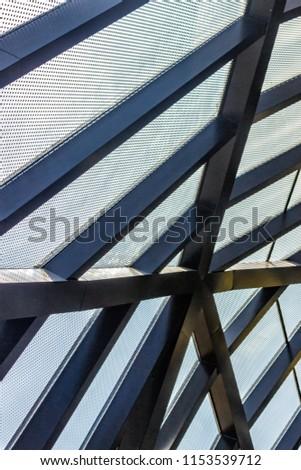 Support structure under the ceiling made of metal. Steel structures of industrial or public buildings. #1153539712