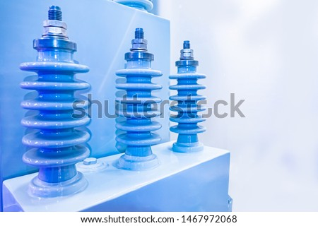 Supporting ceramic insulators. Electro insulating material. Electrical insulating ceramics. Electroporcelain. Insulators for high voltage. Electrical industry.