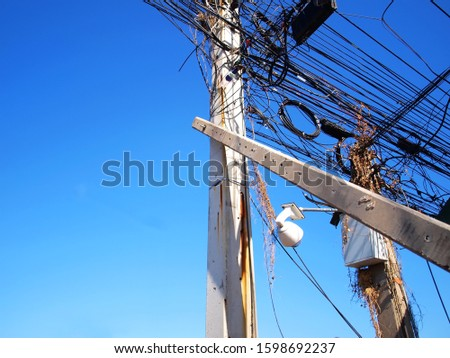 Supporting posts or reinforced with concrete electric poles On the background of the electricity pole with many cables and blue sky With copy space.