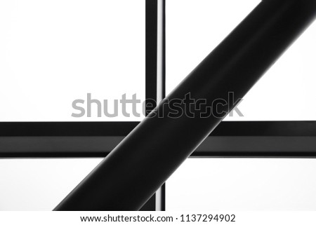 Supporting structure. Modern architecture, construction industry or technology background. Grunge framework of industrial or office building. Metal girder and fragment of structural glazing. #1137294902