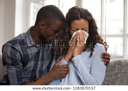 Supportive african husband embracing crying wife asking for forgiveness or consoling comforting helping sharing grief or problem, apology, compassion, empathy in black couple relationships concept