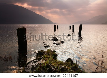 Supports for old jetty lead out into Loch Lomond