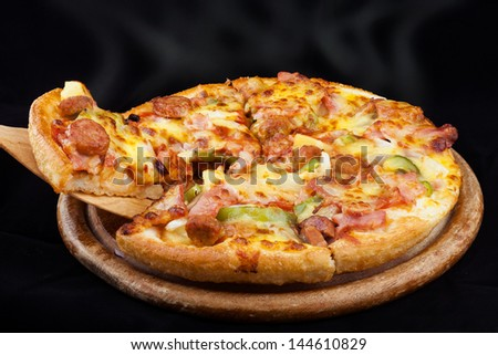 Supreme Hot Pizza lifted with black blackground