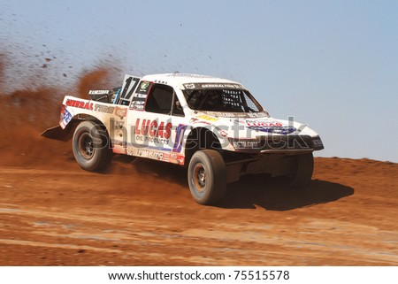 SUPRISE, AZ - APR 16: Carl Renezeder (17) at speed in Pro 4 Unlimited Lucas Oil Off Road Series racing on April 16, 2011 at Speedworld Off Road Park in Avondale, AZ.