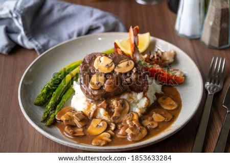 surf and turf, lobster tail and tenderlon steak with mushroom gravy sauce Сток-фото ©