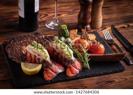 surf and turf with tomahawk rib eye steak and lobster tail