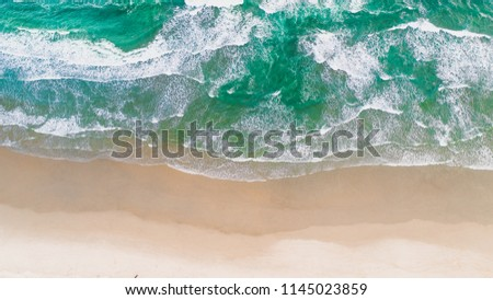 Surf Beach Aerial, Beach on aerial drone top view with ocean waves reaching shore, top view aerial photo from flying drone of an amazingly beautiful sea landscape. Ocean Wallpaper.  #1145023859