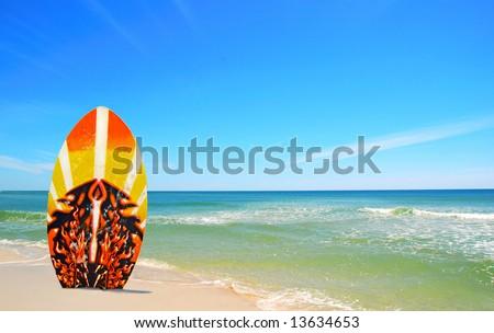 Surf board in sand at pretty beach