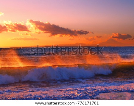 Surf spray colored burnt orange by the sunset in Chiba Japan #776171701