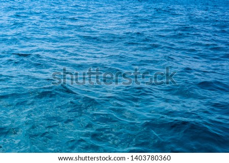 Surface blue sea water. Texture of water with small waves. #1403780360
