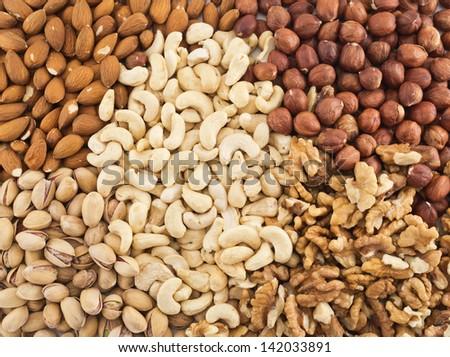 Surface covered with peanut, hazelnut, walnut, almond, pistachio nut mix