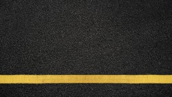 Surface grunge rough of asphalt, Seamless tarmac dark grey with yellow line on the road and small rock, Texture Background, Top view