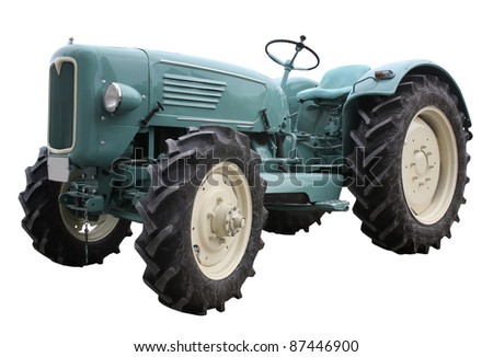 surface level view of a nostalgic blue tractor isolated on white