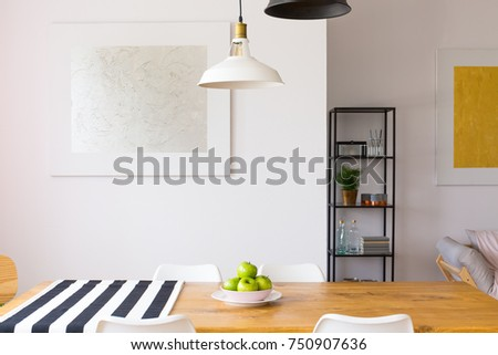 Surface of a wooden, dining table with a bowl of healthy apples, and a piece of fabric #750907636