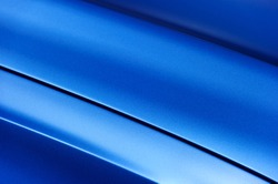 Surface of blue sport sedan car metal hood; part of vehicle bodywork