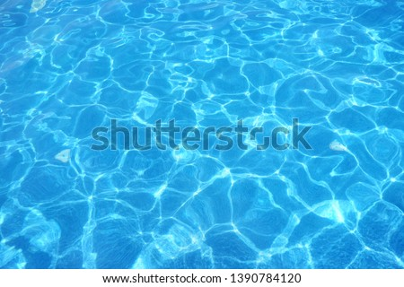 Surface of blue swimming pool, water in swimming pool Background.