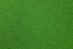 Surface of fake green grass for background or backdrop.