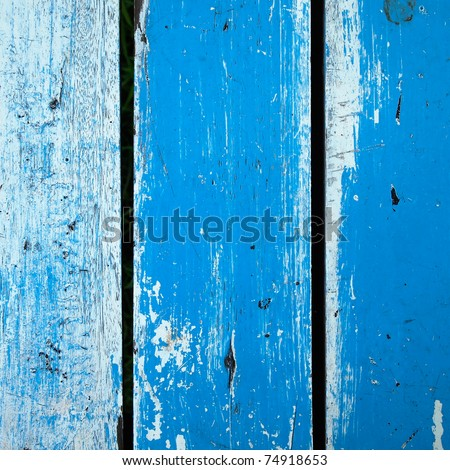 Surface of old wood Paint over with white and blue vertical