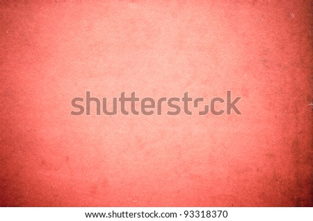 Surface of pastel red paper with circular gradient