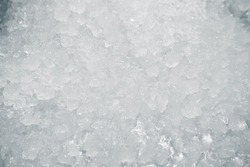 Surface of pile of ice in fish restaurant. Selective focus. Shallow depth of field. Toned.