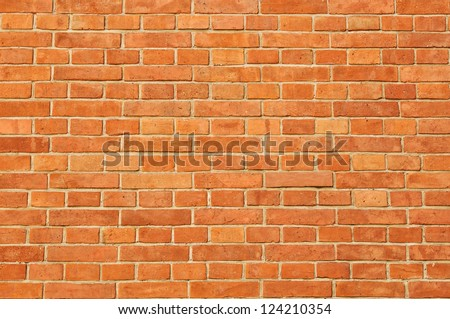 Surface of red regular  brick wall texture