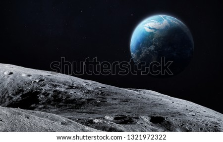 Surface of the Moon. Earth on background. Satellite of our planet. Elements of this image furnished by NASA
