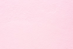 Surface pink pastel cement wall texture for background.