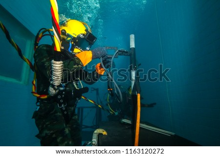surface supplied commercial diver. diver. Underwater. #1163120272
