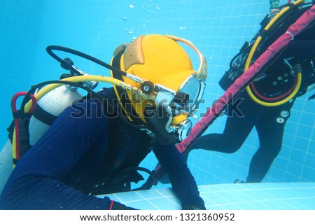 surface supplied commercial diver. diver. Underwater. #1321360952