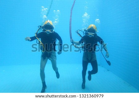 surface supplied commercial diver. diver. Underwater. #1321360979