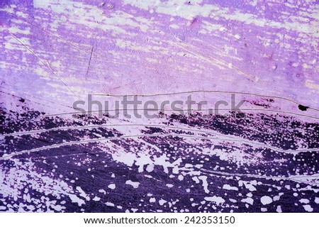 Surface with discolored purple paint flaking and cracking background texture