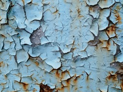 Surface with rusty spots. Corrosion painted metal. Background with cracked turquoise paint. Rusty pattern.